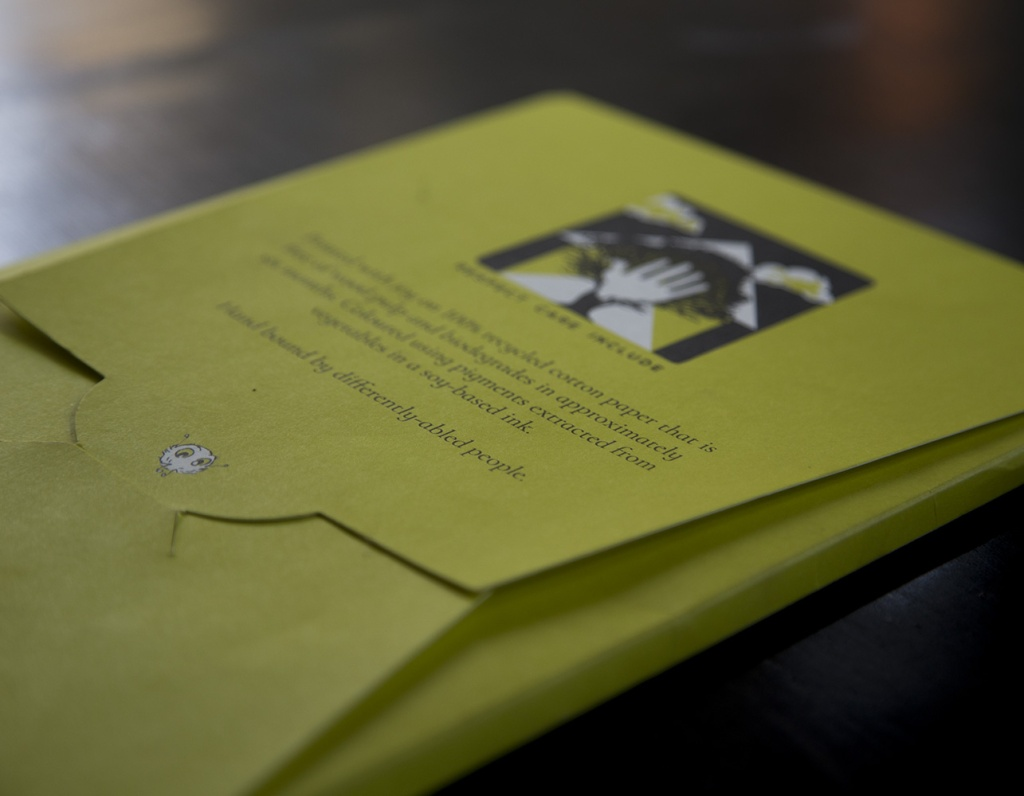 Printed with joy on 100% recycled, sun dried cotton paper, using soy-based inks. Hand bound by differently-abled people.  Book sleeve back - Kyo and Obi.